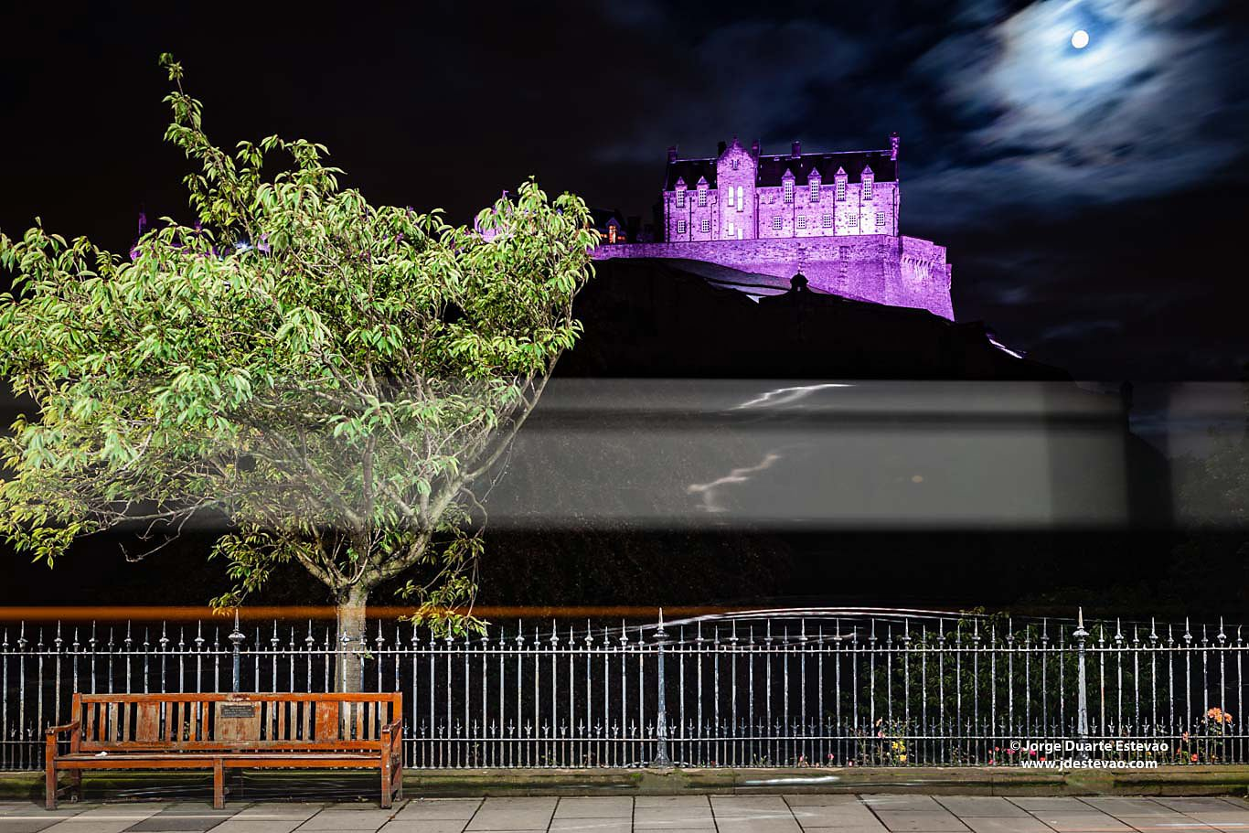 Full moon over purple lit Edinburgh Castle night tree bench edinburgh street scotland
