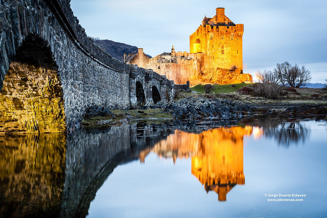 Eilean Donan castle Highlands Scotland reflection sunset