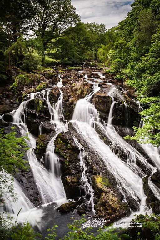 Swallow Falls is the highest continuous waterfall in Wales, United Kingdom. The falls are located on the River Llugwy, inside Snowdonia National Park