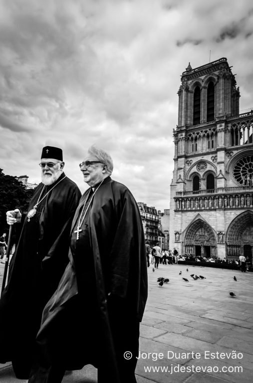 Two priests outside Notre Dame cathedral in Paris, France